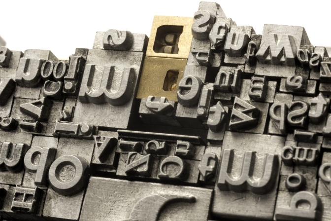 Metal Letterpress Types A background from many historic typographical letters in black and white with white background.